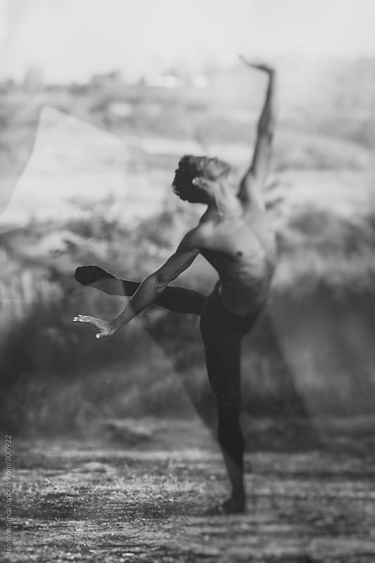Black and white,Ballet dancer dance in nature at sunset by Igor Madjinca for Stocksy United