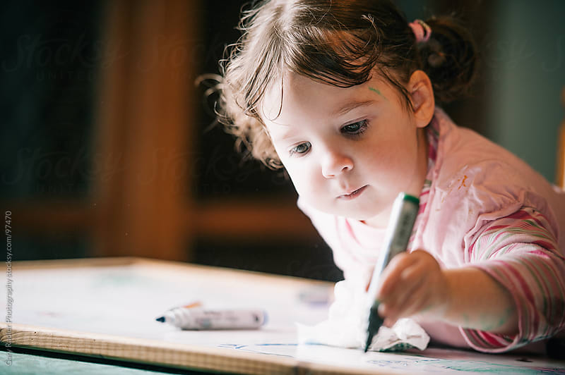 Toddler drawing with a Felt Pen on a Whiteboard by Gary Radler Photography for Stocksy United