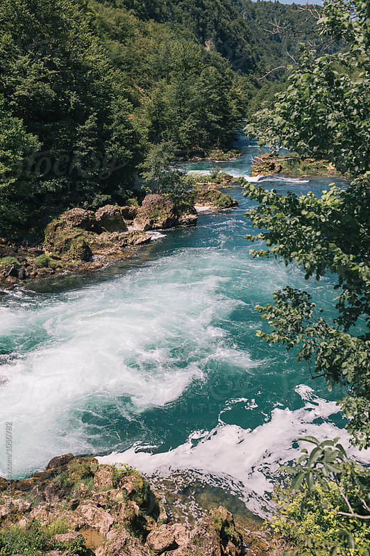 Beautiful emerald river flowing  by Maja Topcagic for Stocksy United