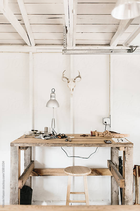 workspace in white modern rustic studio by Nicole Mason for Stocksy United