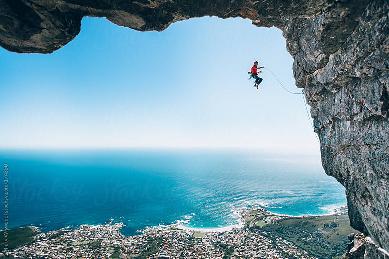 Rock climber taking a fall on Table Mountain, Cape Town by Micky Wiswedel for Stocksy United