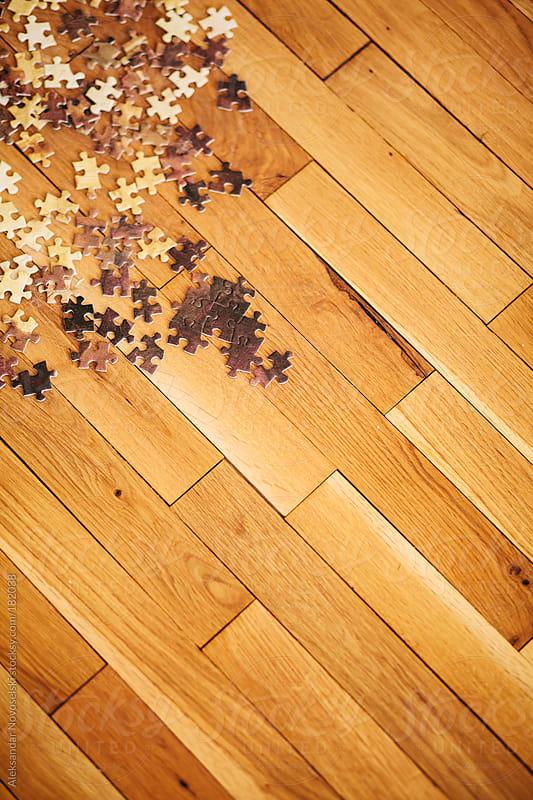 Puzzle on floor by Aleksandar Novoselski for Stocksy United