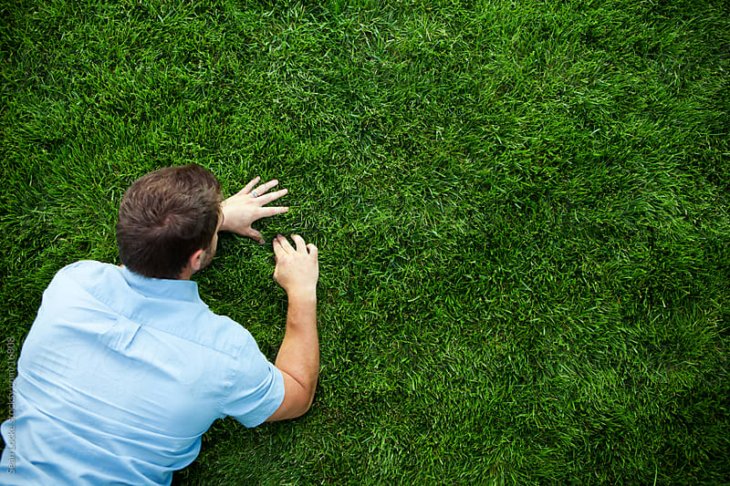 Grass: Man Working to Have the Perfect Grass by Sean Locke for Stocksy United