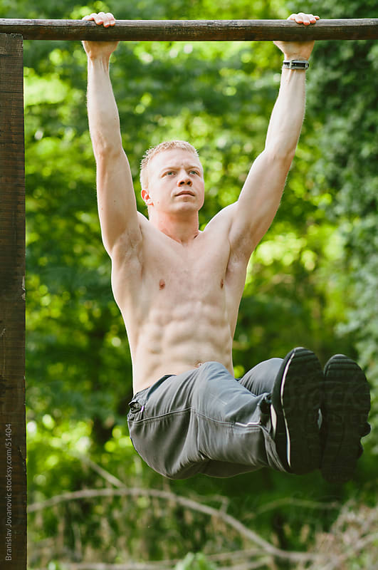 Abdominal muscle workout in nature by Branislav Jovanović for Stocksy United
