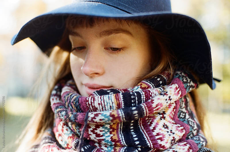 Close up portrait of a woman wrapped in a scarf by Lyuba Burakova for Stocksy United