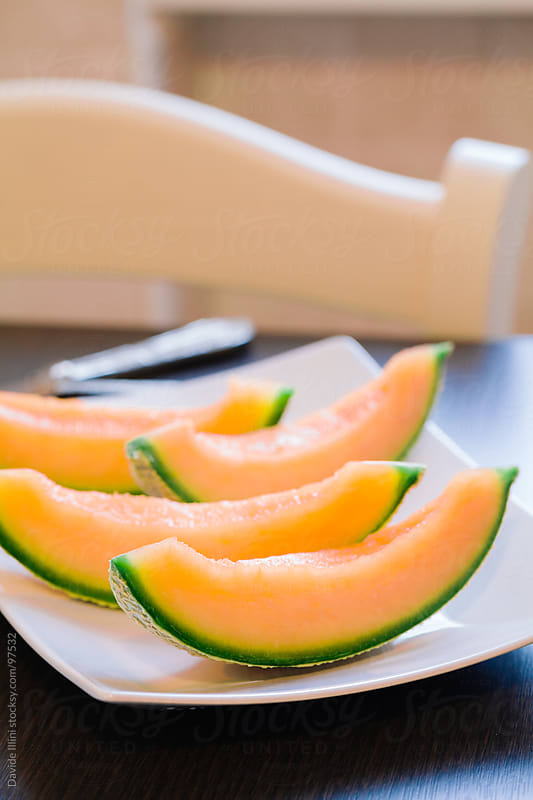 Melon slices by Davide Illini for Stocksy United