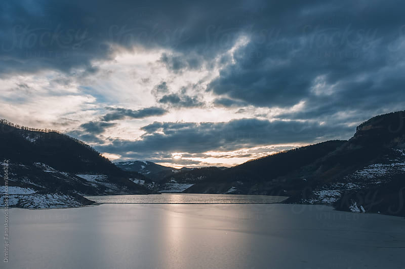 Amazing sunset above the mountain lake by Dimitrije Tanaskovic for Stocksy United