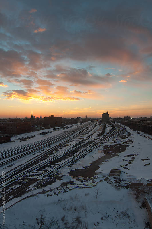urban sunset in winter by Margaret Vincent for Stocksy United