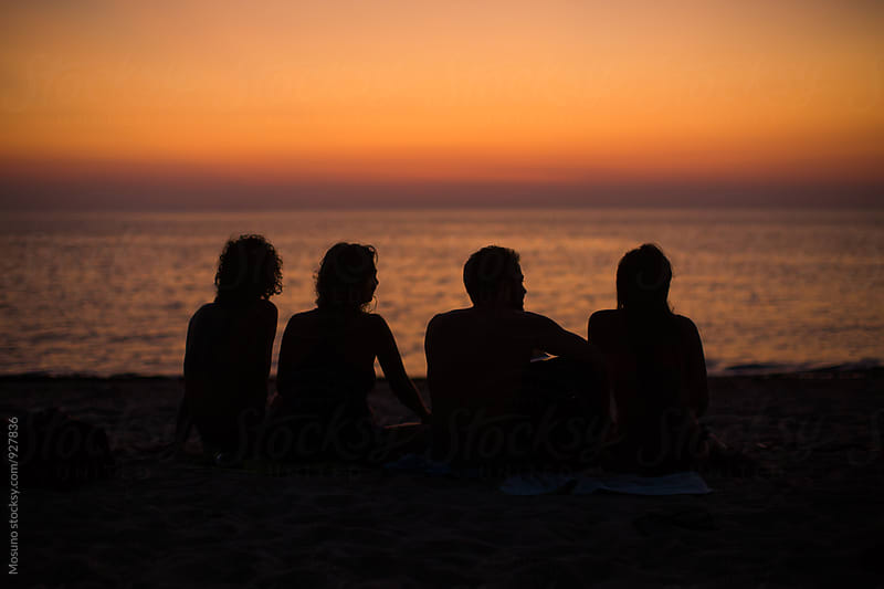 Friends Enjoying the Sunset at the Beach by Mosuno for Stocksy United