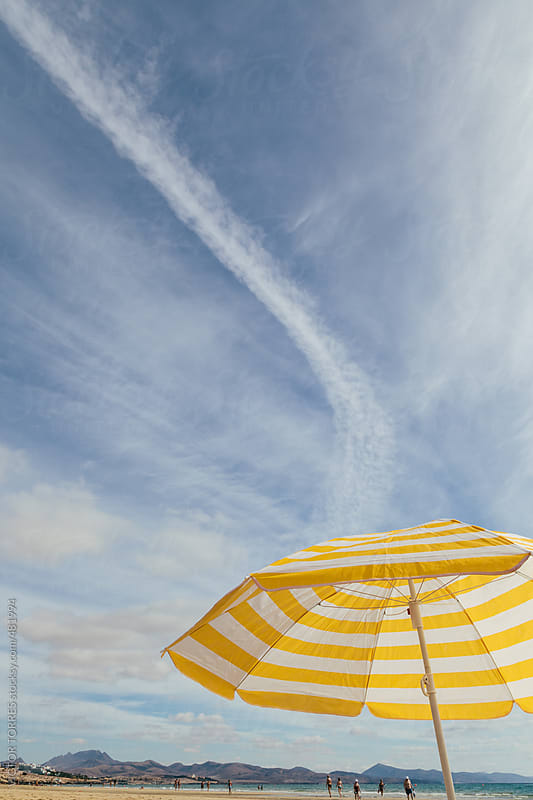 Beach Umbrella in a Sunny Day by VICTOR TORRES for Stocksy United