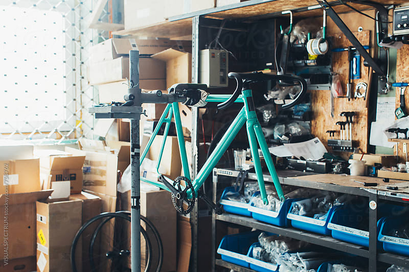New Turquoise Race Bike in Bike Workshop by VISUALSPECTRUM for Stocksy United