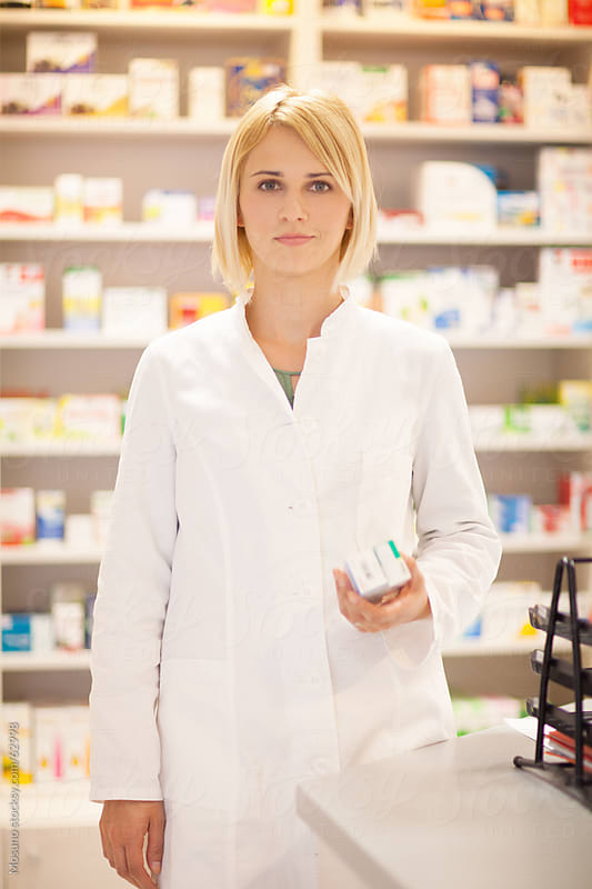 Female pharmacists working in a pharmacy. by Mosuno for Stocksy United
