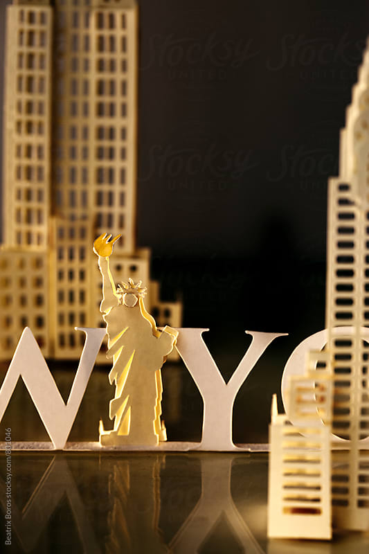 Statue of liberty by night with NYC text and buildings by Beatrix Boros for Stocksy United