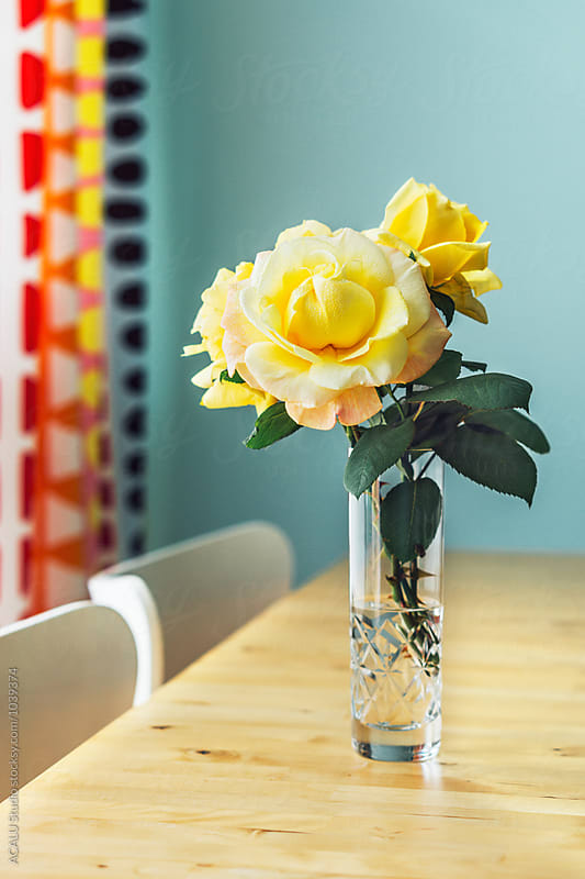 Yellow rose in a flower vase with water