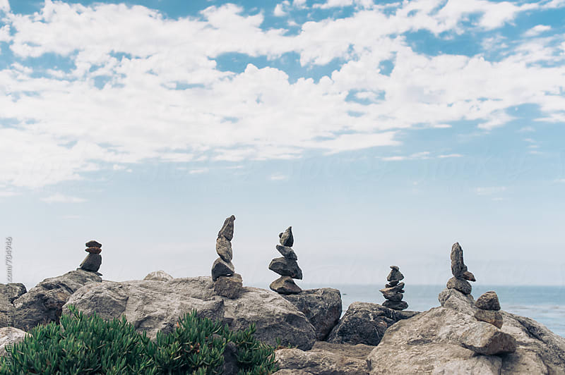 Stacked Zen Rock Piles by the Ocean by Briana Morrison for Stocksy United