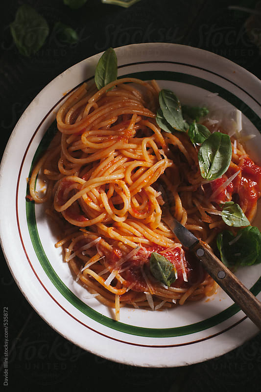 Spaghetti with tomato sauce and basil by Davide Illini for Stocksy United