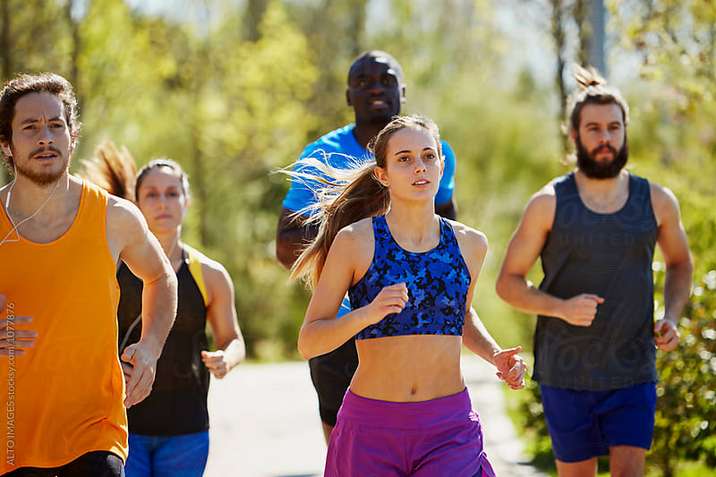 Sporty Athletes Jogging On Street by ALTO IMAGES for Stocksy United