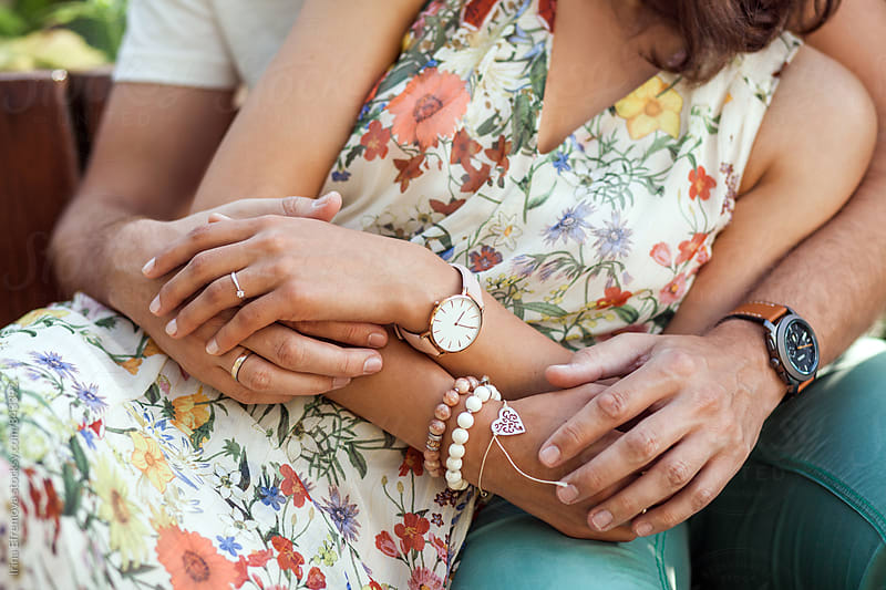 Close up of the embracing couple's hands by Irina Efremova for Stocksy United
