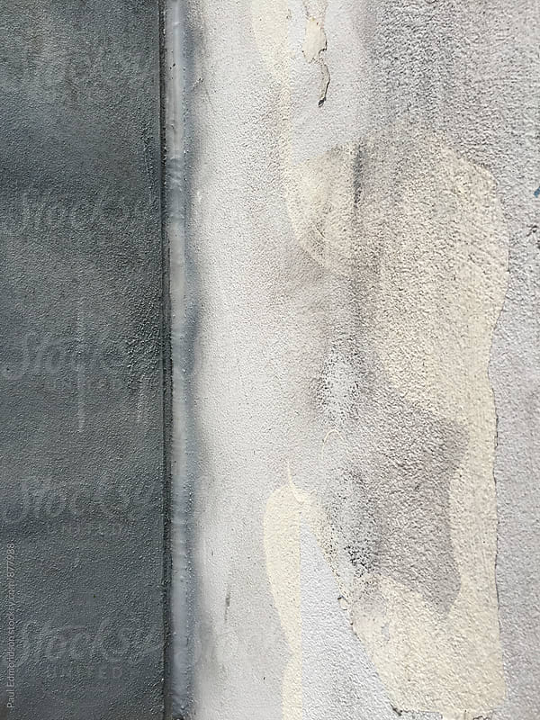 Close up of paint covering graffiti markings on concrete wall by Paul Edmondson for Stocksy United