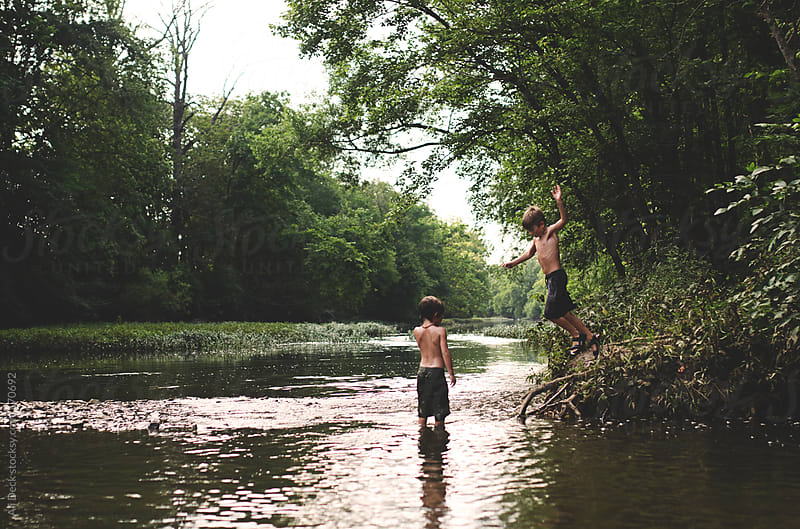 Two Boys Jump in a Creek by Ali Deck for Stocksy United