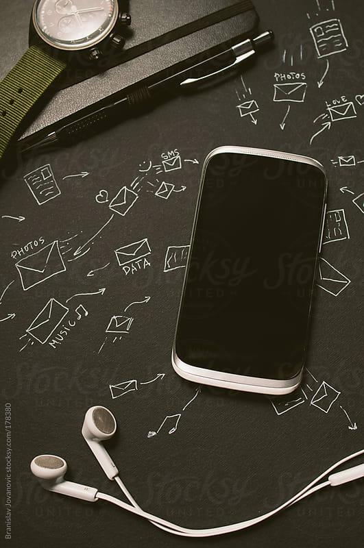 Mobile phone receiving and sending data by Brkati Krokodil for Stocksy United