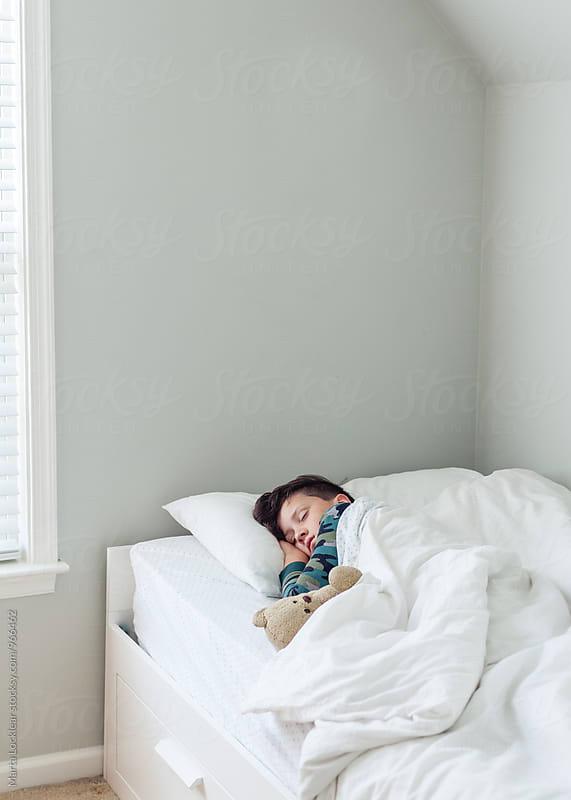 Boy sleeping in his room by Marta Locklear for Stocksy United