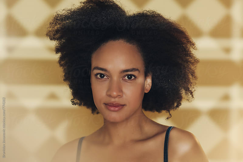 Portrait of a Beautiful Young Woman with Afro Hairstyle by Brkati Krokodil for Stocksy United