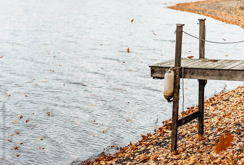 lake dock in autumn by Deirdre Malfatto for Stocksy United