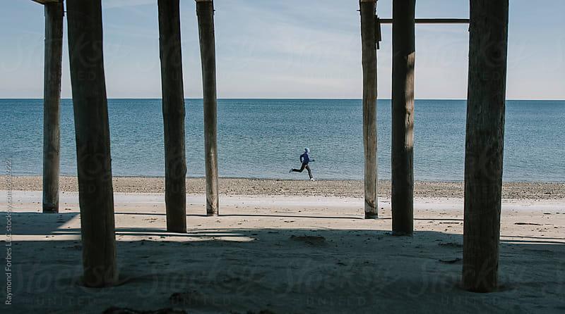 Winter Run on Beach by Raymond Forbes LLC for Stocksy United