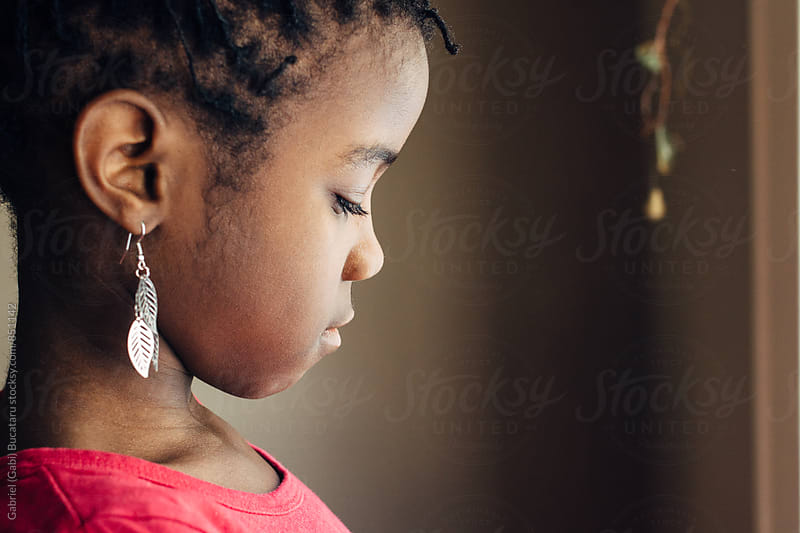 Profile of a cute black girl by Gabriel (Gabi) Bucataru for Stocksy United