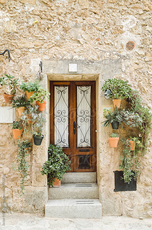Door and pots of a house by Javier Marquez for Stocksy United