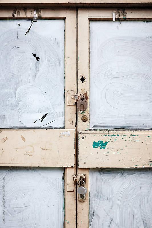 Locked doors by James Ross for Stocksy United