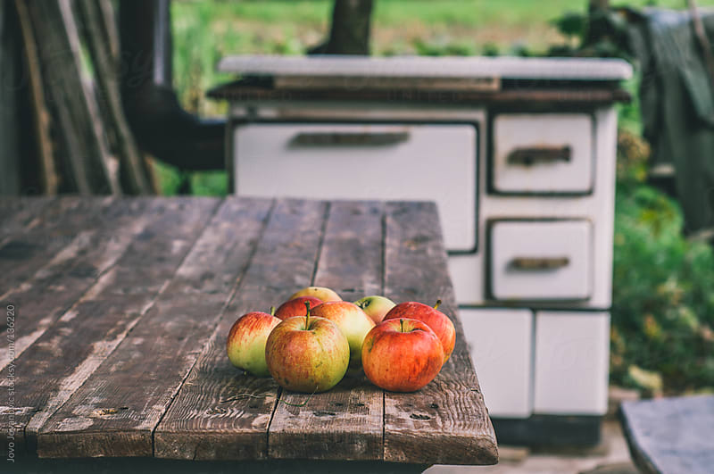 Bunch of organic apples on wooden table.  by Jovo Jovanovic for Stocksy United
