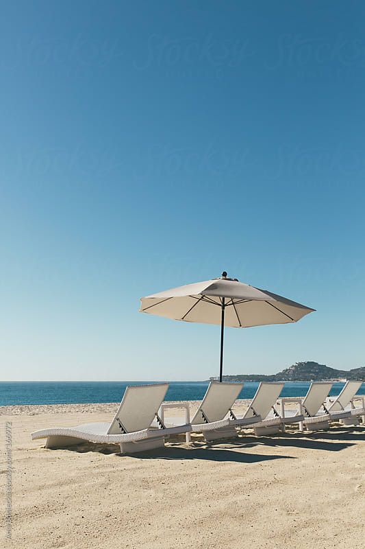 Vacation beach with a bunch of folding chairs by Ania Boniecka for Stocksy United