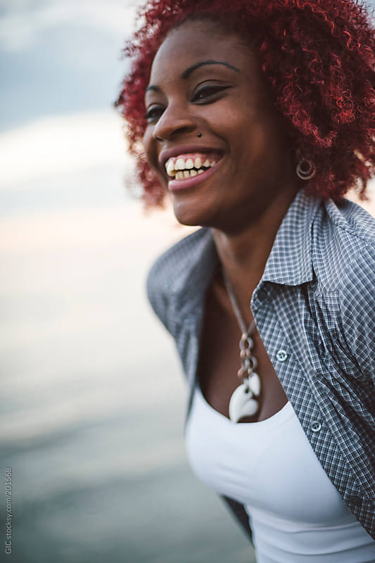 Black young woman on the beach by GIC for Stocksy United
