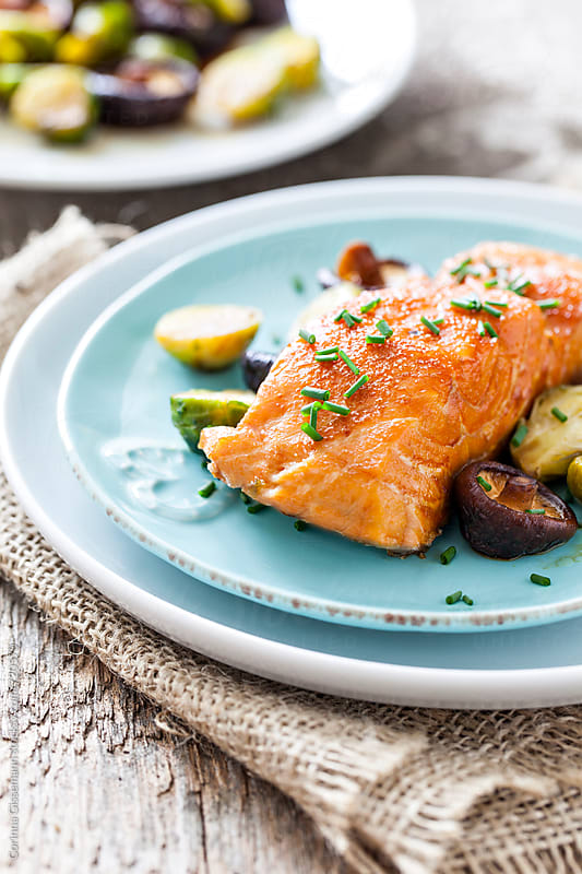 Salmon with vegetables by Corinna Gissemann for Stocksy United