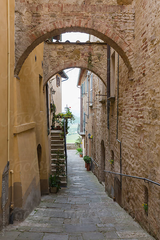 Alley with arches in a Tuscan village by Marilar Irastorza for Stocksy United