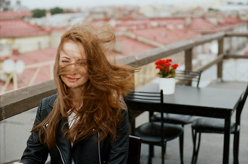 Woman with wind in her hair by Lyuba Burakova for Stocksy United