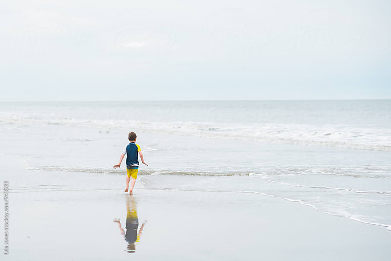 boy in the ocean by Léa Jones for Stocksy United