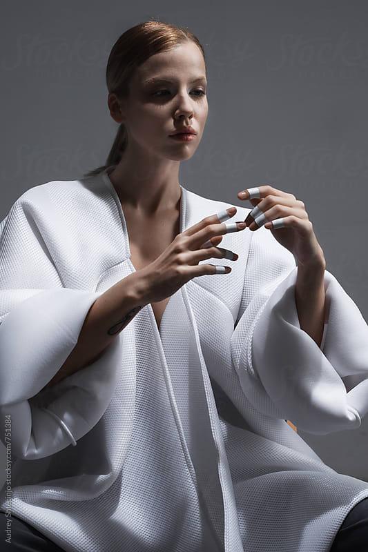 Sensual portrait of female in white kimono by Audrey Shtecinjo for Stocksy United