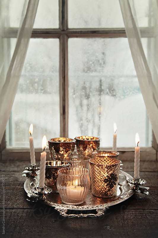 Votive candles on silver tray by Sandra Cunningham for Stocksy United