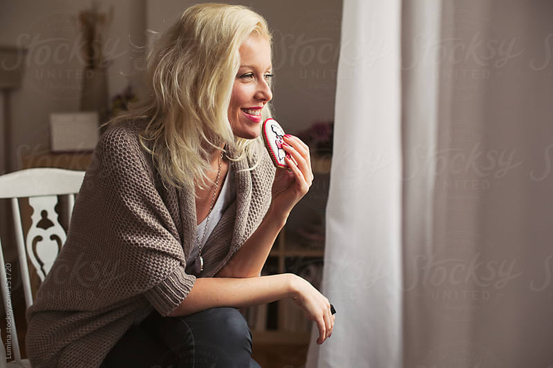 Woman Eating a Cookie by Lumina for Stocksy United