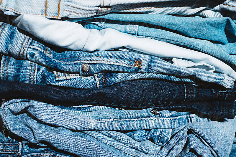 Pile of Jeans  by Katarina Radovic for Stocksy United