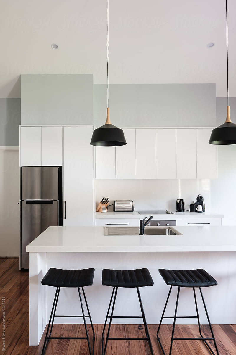Picture of: Contemporary Kitchen Interior With Island Bench And Bar Stools By Rowena Naylor Stocksy United