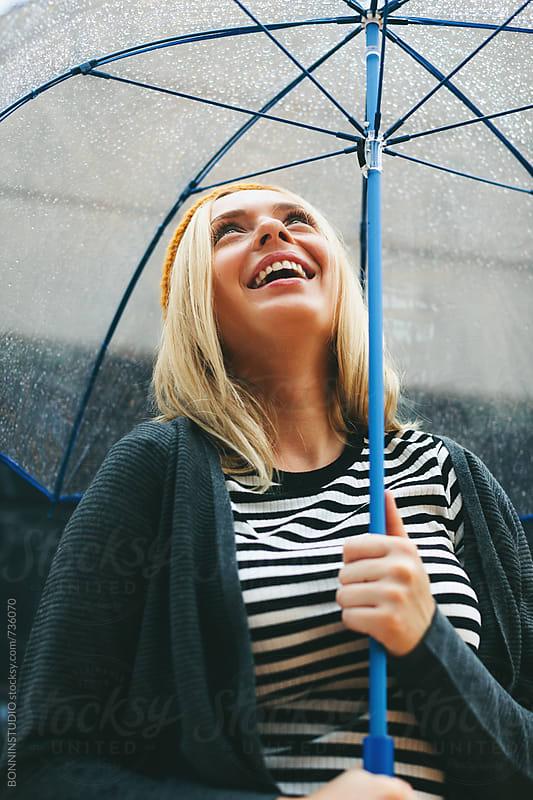 Woman enjoying under the rain. by BONNINSTUDIO for Stocksy United