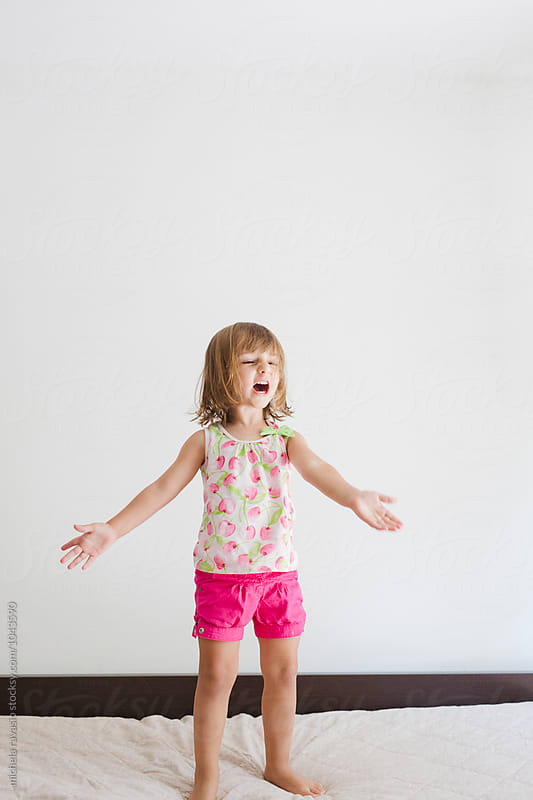 Funny little girl sings loudly by michela ravasio for Stocksy United