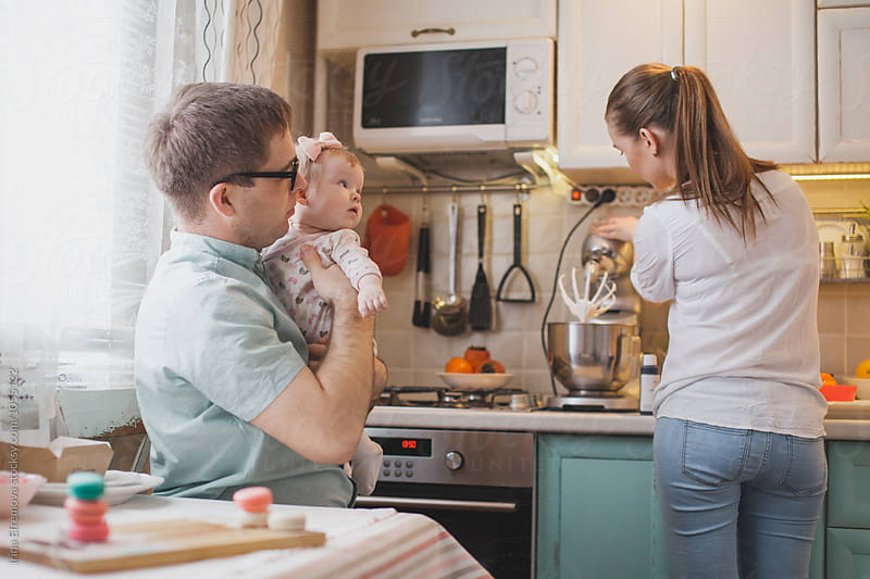Family of four in their tiny kitchen baking macaroons by Irina Efremova for Stocksy United