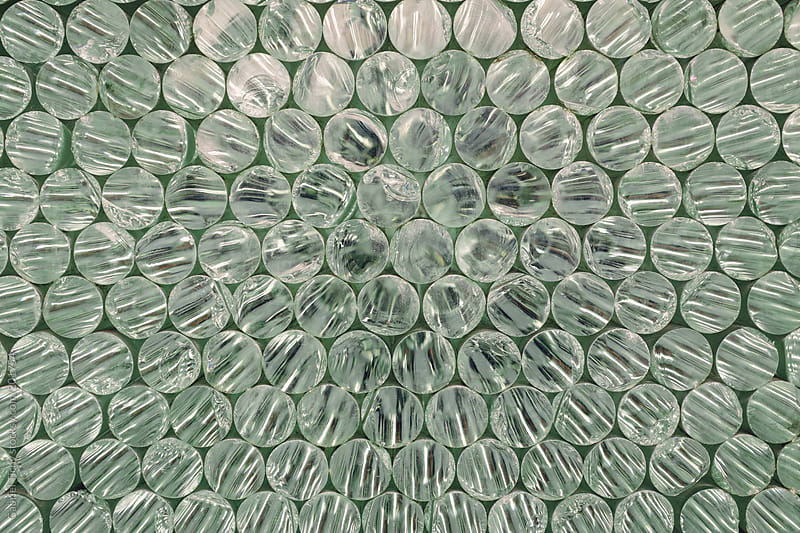 Array of glass discs by Gabriel Tichy for Stocksy United
