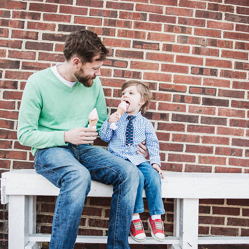 Father and Son eating ice cream by Cameron Whitman for Stocksy United