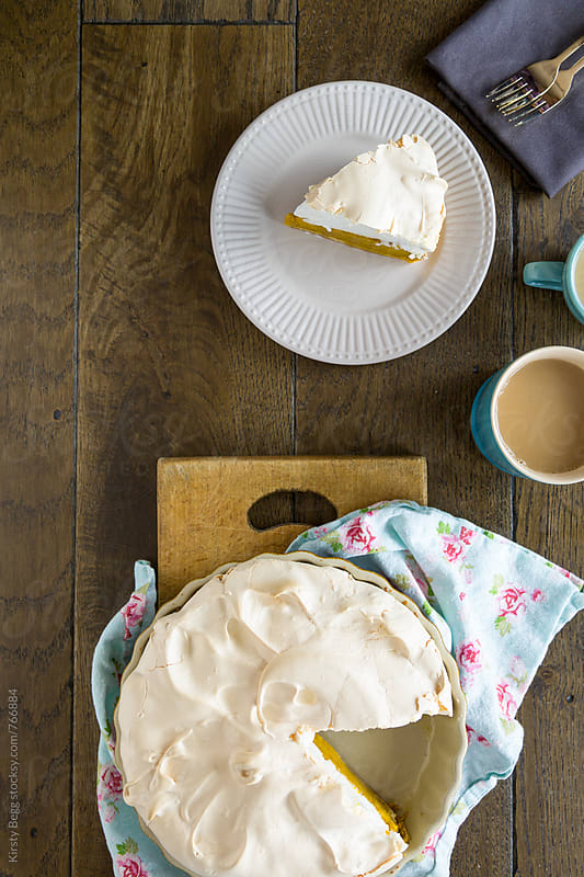 Slice of pumpkin pie with meringue top, overhead by Kirsty Begg for Stocksy United